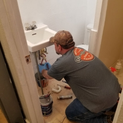 Sean fixing sink